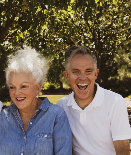 Man and woman laughing outside