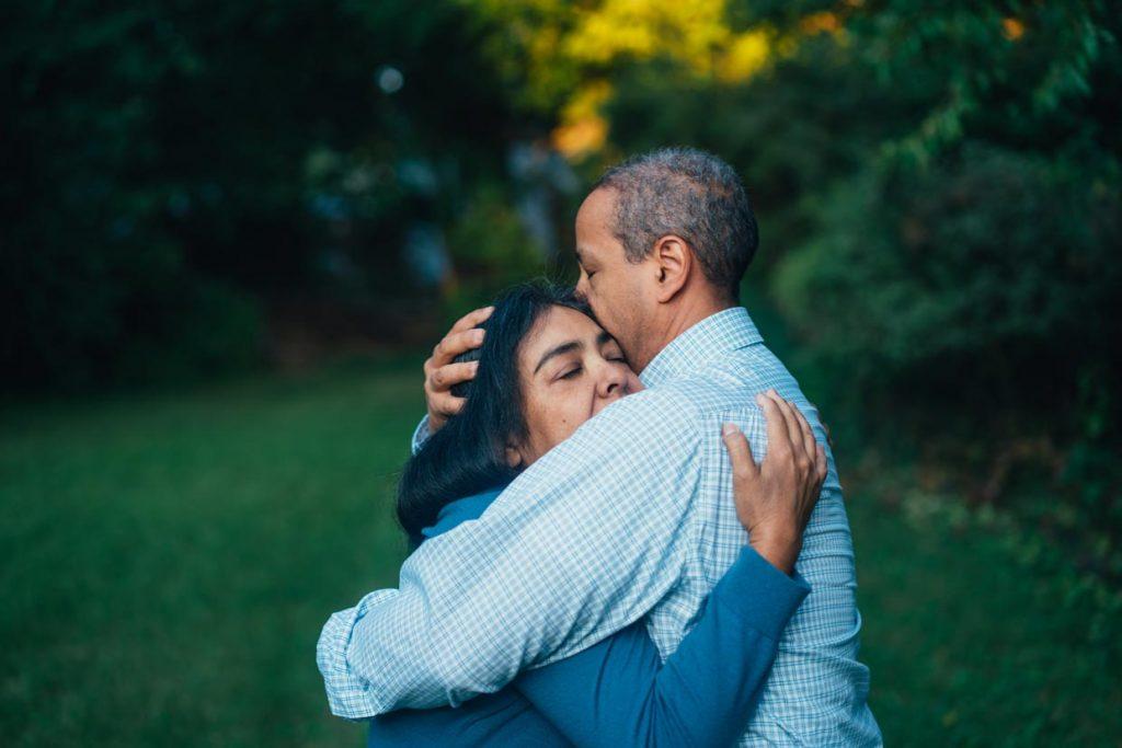 Man and woman embrace outside