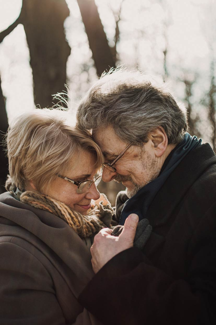 Man and woman happily engaged in an intimate moment.