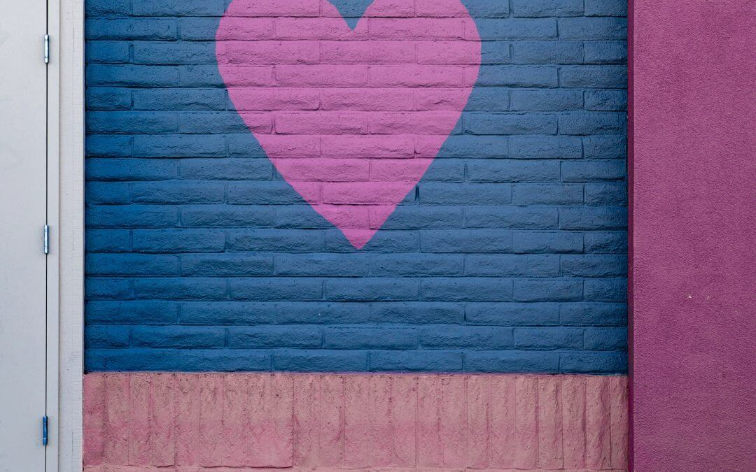A painted heart on a warehouse garage door.