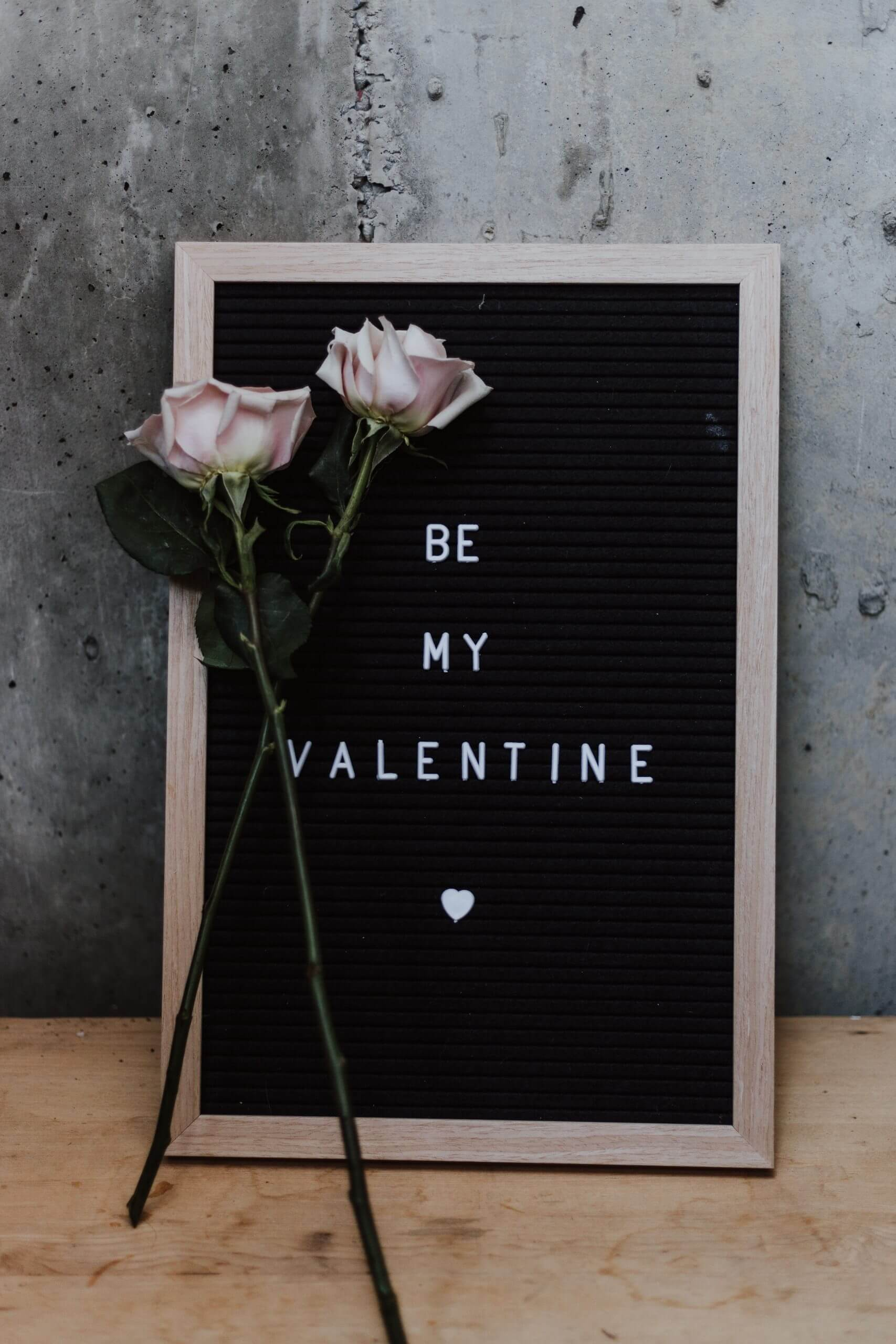 'Be My Valentine' in text on a board.
