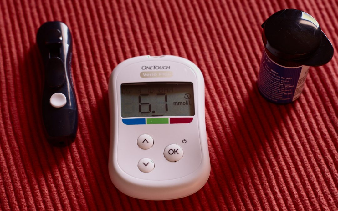 Diabetes gadgets on a red background.